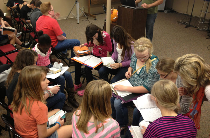 jr high students studying the Bible